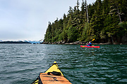 Kayaking along the shore of the Eagle River State Recreation Area in the Lynn Canal, the deepest fjord in North America, North of Juneau, Alaska, May 28, 2017. (David Lienemann)