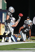 OAKLAND, CA - DECEMBER 19:  Wide receiver Drew Bennett #83 (caught 13 passes for 160 yards and 2 touchdowns) of the Tennessee Titans catches a 23 yard touchdown pass in the 2nd quarter for a 14-14 tie while defended by Stuart Schweigert #30 and Denard Walker #25 of the Oakland Raiders at Network Associates Coliseum on December 19, 2004 in Oakland, California. The Raiders defeated the Titans 40-35. ©Paul Anthony Spinelli *** Local Caption *** Drew Bennett;Stuart Schweigert;Denard Walker