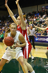 18 March 2011: Stacey Arlis backs in against Hannah Cusworth during an NCAA Womens basketball game between the Washington University Bears and the Illinois Wesleyan Titans at Shirk Center in Bloomington Illinois.