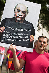 "© Licensed to London News Pictures . 10/08/2013 . London , UK . A protester with a placard condemning Russian President , Vladimir Putin , as a murderer and torturer . Demonstration against homophobic laws being enacted in Russia on Whitehall this afternoon (10th August 2013) . Legislation includes banning gay pride events for100 years , banning the distribution of "" propaganda of non-traditional sexual relations "" to minors , making it illegal for the adoption of Russian children by gay couples or any single person who comes from a country that recognises marriage equality and giving authorities the rights to arrest foreign nationals whom they suspect are LGBT or pro gay with the right to detain them for up to 14 days. Photo credit : Joel Goodman/LNP"