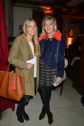 Left to right, ELIZA WINWOOD and LUCY LAMBERT at the fourth annual Fayre of St James's charity Christmas concert hosted by the Quintessentially Foundation and The Crown Estate in partnership with Deutsche Asset & Wealth Management held at  St James's Church, 197 Piccadilly, London followed by a party at Quaglino's 16 Bury Street, London on 24th November 2015.