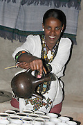 Africa, Ethiopia, Lalibela, Woman makes coffee in porcelain cups