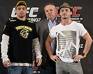 BIRMINGHAM, ENGLAND, NOVEMBER 3, 2011: Renan Barao (left) and Brad Pickett pose for photographs at the pre-fight press conference for UFC 138 inside the Hilton Hotel on November 3, 2011.