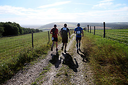 UK ENGLAND 29JUL17 - The first teams of runners and hikers make their way to checkpoint 2 at Hilltop Farm during the Trailwalker 2017 challenge across the South Downs National Park, England.<br /> <br /> jre/Photo by Jiri Rezac<br /> <br /> © Jiri Rezac 2017