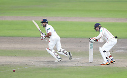 Essex batsman Ravi Bopara hits out from the bowling of Lancashire's Stephen Parry watched by wicketkeeper Jos Buttler during day three of the Specsavers County Championship, Division 1 match at Emirates Old Trafford, Manchester.