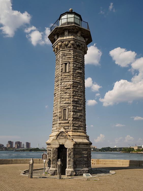 The Lighthouse on Roosevelt Island, New York, NY. Designed by engineer and self-trained architect James Renwick, Jr., the Gothic style octagonal stone lighthouse was completed in 1873. It was built with gray gneiss quarried on the island mostly by convict labor from the penitentiary there.