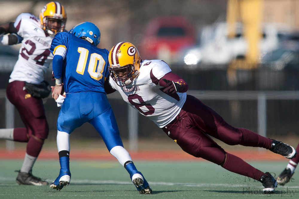Glassboro High School's Antoine Alicea (8); Pennsville Memorial High School's Dylan Cummings (10)..NJSIAA South Jersey Group 1 Title match between Pennsville High School and Glassboro High School held at Coach Richard Wacker Stadium on the campus of Rowan University in Glassboro, NJ on Saturday, December 3, 2011. (photo: Mat Boyle)