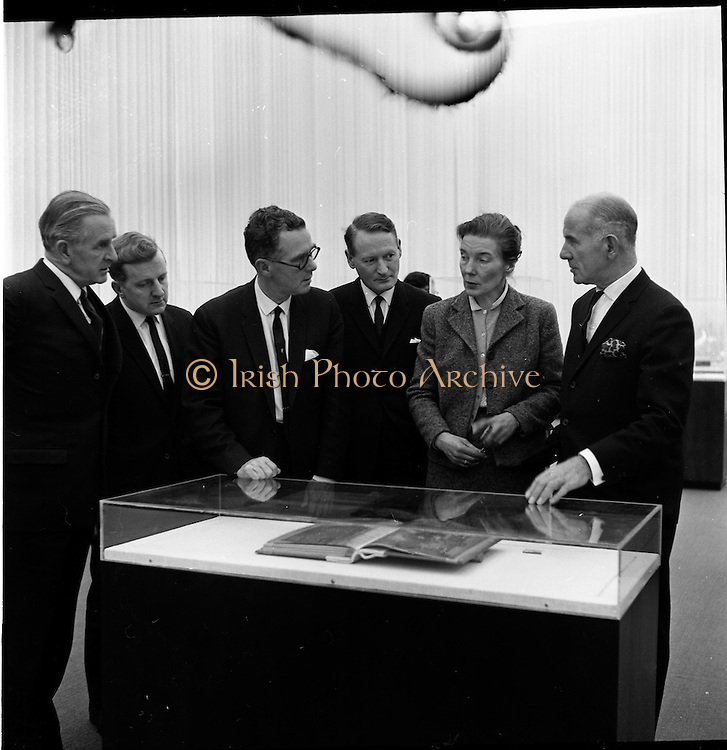 14/11/1967<br /> 11/14/1967<br /> 14 November 1967<br /> ROSC 1967 Exhibition at the National Museum. The exhibition of Celtic Art held at the National Museum, Kildare Street in connection with the ROSC Exhibition of Modern Art was opened to the public on Tuesday.   Picture shows from left: Mr M.K. O'Doherty (Bord Failte), Acting Chairman ROSC Committee; Mr Alan Glynn, ROSC Committee; Mr Tim Dennehy (C.I.E.), ROSC Committee; Mr P.J. Brennan (Aer Lingus); Miss Prendergast, Assistant Keeper of Irish Antiquities National Museum and Dr. T.J. O'Driscoll, Director - General, Bord Failte, viewing the Book of Kells on exhibition at the National Museum.