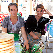 Local women selling bread (çörek) in a Dashoguz market, Turkmenistan