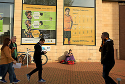 A homeless man sits outside Molineux Stadium under a price list of match tickets as fans make their way to the ground - Mandatory by-line: Paul Roberts/JMP - 14/10/2017 - FOOTBALL - Molineux - Wolverhampton, England - Wolverhampton Wanderers v Aston Villa - Skybet Championship