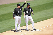 CHICAGO - MAY 21:  Third base coach Jeff Cox #8 of the Chicago White Sox talks things over with Chris Getz #17 during the game against the Minnesota Twins on May 21, 2009 at U.S. Cellular Field in Chicago, Illinois.  The Twins defeated the White Sox 20-1. (Photo by Ron Vesely)