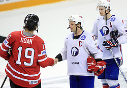 Shane Doan and Tommy Jakobsen after play-off round quarterfinals ice-hockey game Norway vs Canada at IIHF WC 2008 in Halifax,  on May 14, 2008 in Metro Center, Halifax, Nova Scotia,Canada. (Photo by Vid Ponikvar / Sportal Images)