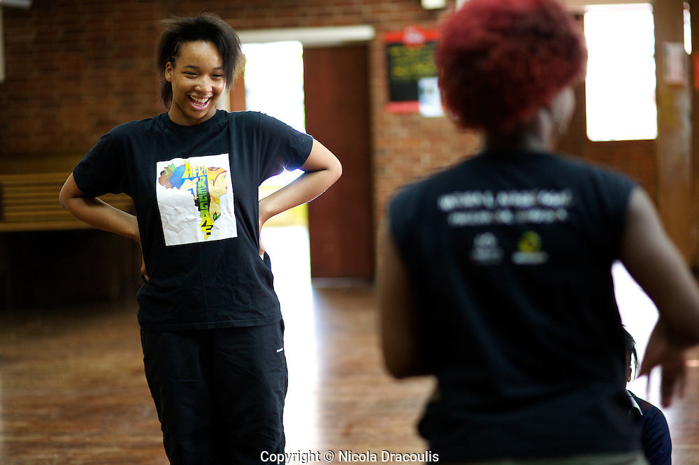 Amy laughing during a dance class at Hackney Free School. ..AfroReggae Hackney, London, May-September 2008, Nicola Dracoulis