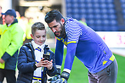 Francisco Casilla of Leeds United (33) taking a selfie with a fan during the warm up during the EFL Sky Bet Championship match between Preston North End and Leeds United at Deepdale, Preston, England on 9 April 2019.