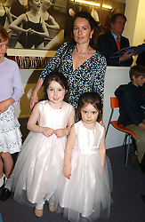 SIOBHAN GILDAY and her daughters Left, MILLIE and right, LOTTIE at a performance by the London Childrens Ballet of 'The Little Princess' at The Peacock Theatre, Portugal Street, London WC2 on 19th May 2005.<br />