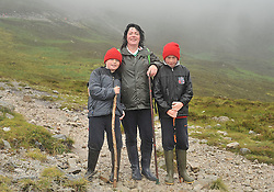 Despite the cancellation notices on Reek sunday Luke and Patrick Carney with mun Monica from Islandeady climbed Croagh Patrick on sunday last.<br /> Pic Conor McKeown