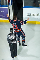 KELOWNA, BC - DECEMBER 27: Ryley Appelt #23 of the Kamloops Blazers is escorted to the dressing room by line official Dave McMahon after dropping the gloves with Jake Lee #21 of the Kelowna Rockets late in the third period at Prospera Place on December 27, 2019 in Kelowna, Canada. (Photo by Marissa Baecker/Shoot the Breeze)