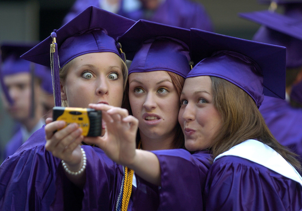 CAPTION: (New Port Richey: 5/19/06) From left, Alana Crumbley (cq), Rachael Day (cq), and Jennifer Francis (cq) make faces for the camera as they take pictures of each other at River Ridge High School Friday (5/19/06) night before the beginning of the 2006 commencement exercises.  STORY SUMMARY: 2006 commencement ceremonies at River Ridge High School in New Port Richey, Fla.  (Times photo by Brendan Fitterer) 2006 Favorite Scene......