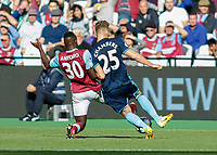 Football - 2016 / 2017 Premier League - West Ham United vs. Middesborough <br /> <br /> Michail Antonio of West Ham blocks Calum Chambers of Middlesborough from passing the ball  at The London Stadium.<br /> <br /> COLORSPORT/DANIEL BEARHAM