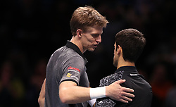 Croatia's Marin Cilic congratulates opponent, Serbia's Novak Djokovic, after their Semi-final match during day seven of the Nitto ATP Finals at The O2 Arena, London.