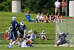 Virginia Cavaliers A Danny Glading (9) shoots and scores from his back, beating Villanova Wildcats Goalkeeper Andrew DiLoreto (33).  The #5 ranked Virginia Cavaliers defeated the #19 ranked Villanova Wildcats 18-6 in the first round of the 2008 NCAA Men's Lacrosse Tournament the University of Virginia's Klockner Stadium in Charlottesville, VA on May 10, 2009.