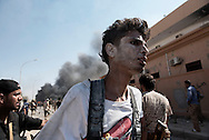 Libya, Sirte: Right after an ISIS car bomb exploded killing three and injuring 15, a shocked by the explosion fighter sympathising with Libya's Government of National Accord's (GNA) looks for an ambulance to take care of him. Alessio Romenzi