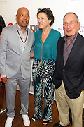 Water Mill, New York: (L-R) Music Mogul Russell Simmons, Diana Taylor and Former New York City Mayor Michael Bloomberg attend the RUSH Philanthropic Arts Foundation 15th Annual Art For Life Benefit Gala held in the Hamptons at the Farmview Farms on July 26, 2014  in Water Mill, New York. (Terrence Jennings)