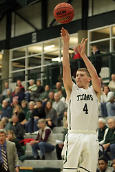 17 November 2015:  Andy Stempel(4) lines up a shot from beyond the 3 point line during an NCAA men's division 3 CCIW basketball game between the Greenville College Panthers and the Illinois Wesleyan Titans in Shirk Center, Bloomington IL