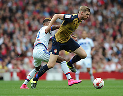 Per Mertesacker of Arsenal battles for the ball with Clinton Njie of Lyon  - Mandatory by-line: Joe Meredith/JMP - 25/07/2015 - SPORT - FOOTBALL - London,England - Emirates Stadium - Arsenal v Lyon - Emirates Cup