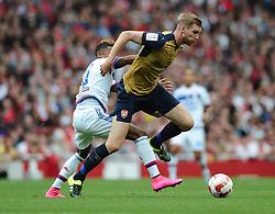Per Mertesacker of Arsenal battles for the ball with Clinton Njie of Lyon  - Mandatory by-line: Joe Meredith/JMP - 25/07/2015 - SPORT - FOOTBALL - London,England - Emirates Stadium - Arsenal v Lyon - Emirates Cup