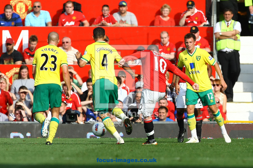 Picture by Paul Chesterton/Focus Images Ltd.  07904 640267.1/10/11.Wayne Rooney of Norwich has a shot on goal during the Barclays Premier League match at Old Trafford Stadium, Manchester.