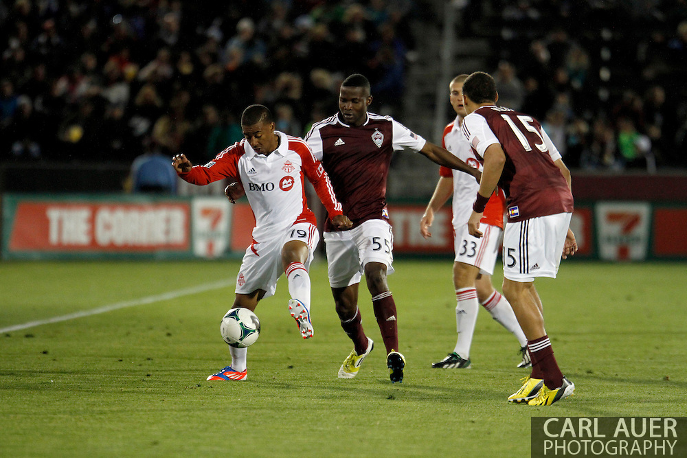 May 4th, 2013 Commerce City, CO - Toronto FC midfielder Reggie Lambe (19) attempts to keep the ball away from Colorado Rapids forward Danny Mwanga (55) in second half action of the MLS match between the Toronto FC and the Colorado Rapids at Dick's Sporting Goods Park in Commerce City, CO
