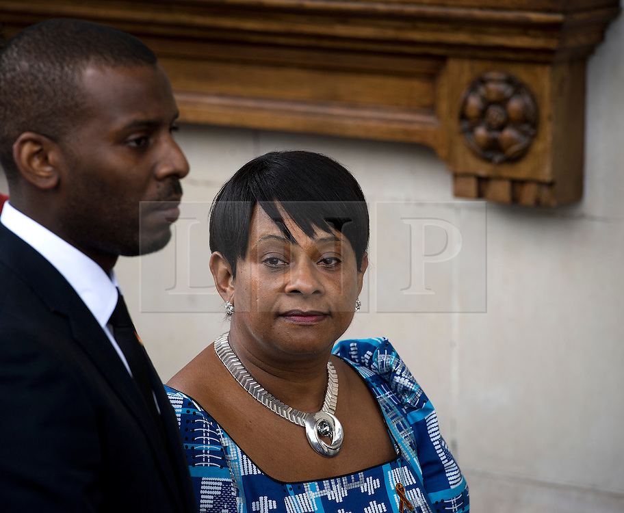 © London News Pictures. 22/04/2013. London, UK.  Stuart Lawrence and Doreen Lawrence (Brother and Mother of Stephen Lawrence) enter St Martins in the Field Church in London for a memorial service to mark the 20 anniversary of the murder of Stephen Lawrence. Stephen Lawrence was murdered in a racist attack while waiting for a bus in SOuth London on the evening of 22 April 1993. Photo credit : Ben Cawthra/LNP