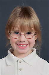 Portrait of young girl wearing glasses smiling,