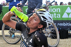 WORCESTER, SOUTH AFRICA - MARCH 21: A rider takes on fluid at the finish of stage three's 122km from Robertson to Worcester on March 21, 2018 in Cape Town, South Africa. Mountain bikers from across South Africa and internationally gather to compete in the 2018 ABSA Cape Epic, racing 8 days and 658km across the Western Cape with an accumulated 13 530m of climbing ascent, often referred to as the 'untamed race' the Cape Epic is said to be the toughest mountain bike event in the world. (Photo by Dino Lloyd)