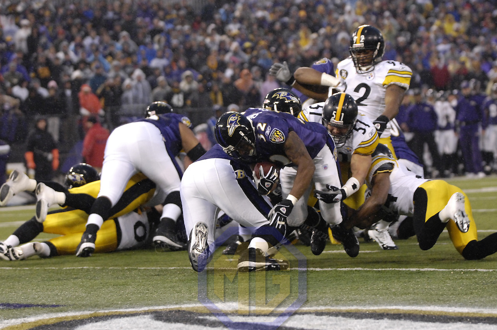 30 December 2007:  Baltimore Ravens running back Musa Smith (32) runs for a  2-yard touchdown against Pittsburgh Steelers linebacker James Farrior (51) in the 1st quarter on December 30, 2007 at M&T Bank Stadium in Baltimore, Maryland. The Ravens defeated the Steelers 27-21.. 30 December 2007:  Baltimore Ravens running back Musa Smith (32) runs for a  2-yard touchdown against Pittsburgh Steelers linebacker James Farrior (51)in the 1st quarter on December 30, 2007 at M&T Bank Stadium in Baltimore, Maryland. The Ravens defeated the Steelers 27-21..