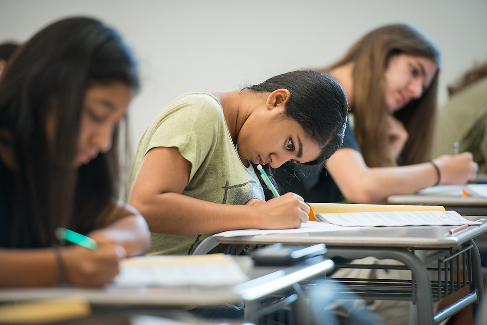 Students take a practice SAT at Carnegie Vanguard High School, July 16, 2014.