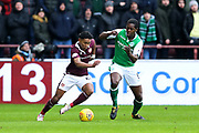 Demetri Mitchell (#24) of Heart of Midlothian on the ball under pressure from Marvin Bartley (#6) of Hibernian during the William Hill Scottish Cup 4th round match between Heart of Midlothian and Hibernian at Tynecastle Stadium, Gorgie, Scotland on 21 January 2018. Photo by Craig Doyle.