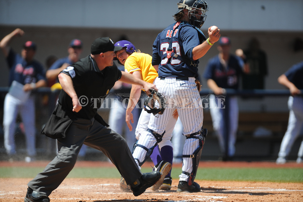 LSU's Andrew Stevenson (6) looks back to see home plate umpire Scott Cline call him out as Mississippi catcher Will Allen holds up the ball following a play at the plate, at Oxford-University Stadium in Oxford, Miss. on Saturday, April 19, 2014. (AP Photo/Oxford Eagle, Bruce Newman)