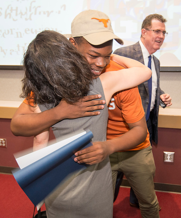 Worthing High School student Traquan Minor hugs Houston ISD Board of Trustees president Juliet Stipeche during the Academic Signing Day activities at the Region 4 Education Center, May 23, 2014.