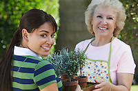 Young woman and mother gardening, portrait
