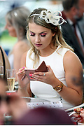 A racegoer checking her mobile at York Racecourse, York, United Kingdom on 26 May 2018. Picture by Mick Atkins.