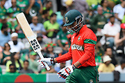 Wicket - Soumya Sarkar of Bangladesh looks dejected as he walks back to the pavilion after being dismissed by Mohammad Amir of Pakistan during the ICC Cricket World Cup 2019 match between Pakistan and Bangladesh at Lord's Cricket Ground, St John's Wood, United Kingdom on 5 July 2019.