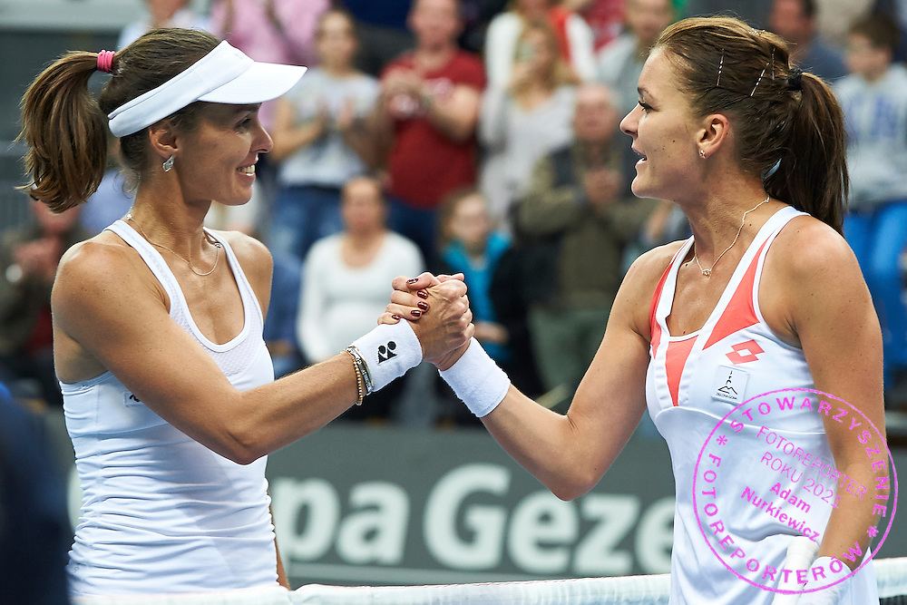 (L) Martina Hingis from Switzerland and (R) Agnieszka Radwanska of Poland after first game while the Fed Cup / World Group Play Off tennis match between Poland and Switzerland on April 18, 2015 in Zielona Gora, Poland<br /> Poland, Zielona Gora, April 18, 2015<br /> <br /> Picture also available in RAW (NEF) or TIFF format on special request.<br /> <br /> For editorial use only. Any commercial or promotional use requires permission.<br /> <br /> Adam Nurkiewicz declares that he has no rights to the image of people at the photographs of his authorship.<br /> <br /> Mandatory credit:<br /> Photo by &copy; Adam Nurkiewicz / Mediasport