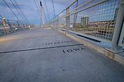 USA, Nebraska and Iowa. State line on the Bob Kerrey Memorial Bridge over the Missouri River.