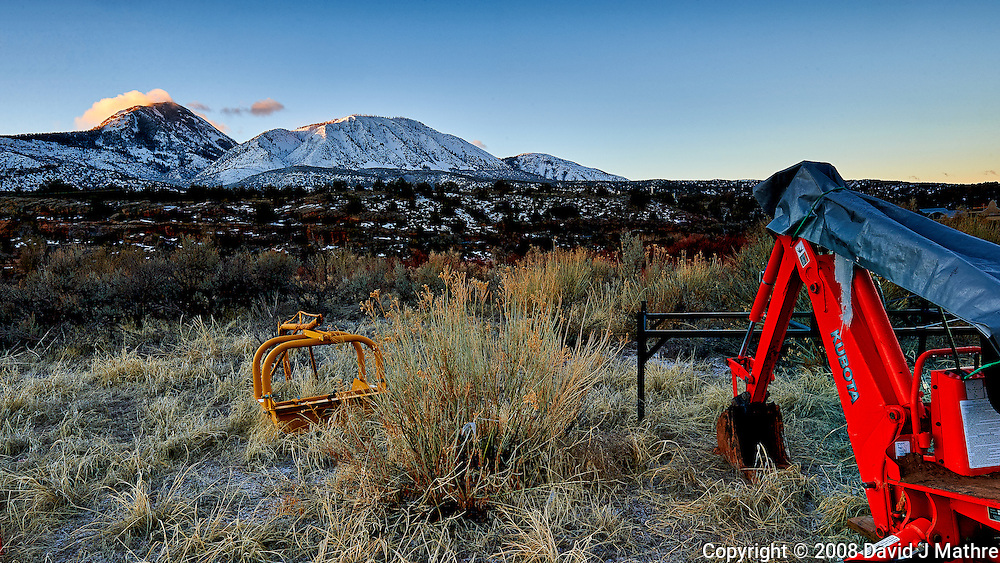 Sleeping Ute Mountain and red back-hoe on an early winter morning at Kelley's Place near Cortez, Colorado. Image taken with a Nikon D3 camera and 14-24 mm f/2.8 lens (ISO 200, 22 mm, f/16, 1/10 sec).