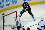 May 26, 2013; San Jose, CA, USA; San Jose Sharks center Joe Thornton (19) scores a goal against Los Angeles Kings goalie Jonathan Quick (32) during the first period in game six of the second round of the 2013 Stanley Cup Playoffs at HP Pavilion.