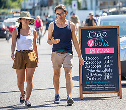 © Licensed to London News Pictures. 07/08/2020. London, UK. Members of the public enjoy the sunshine at Putney Embankment in South West London as temperatures are expected to reach to 35c today. Thousands of sun seekers have flocked to parks, rivers and the south coast as temperatures soar with beaches and roads becoming jammed with holidaymakers. The heat is set to continue for the rest of the week with temperatures expected in the high 20s. Photo credit: Alex Lentati/LNP