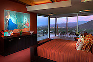Modern home Master bedroom with view of Palm Springs below at sunset. Home owned by Andy Linsky.