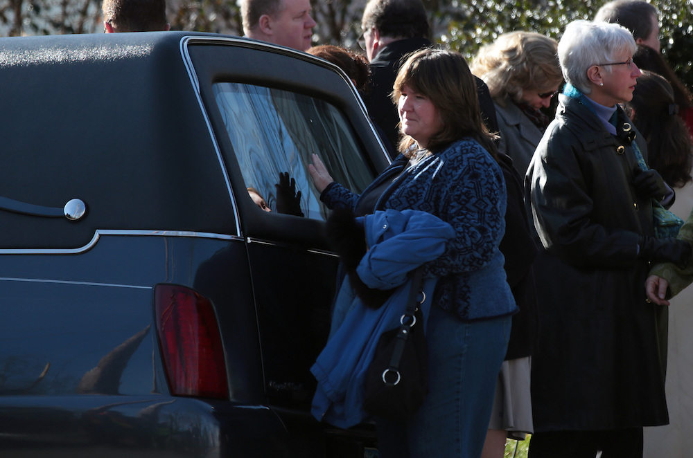 Xavier Mascareñas/Newsday; Mourners pass the funeral coach after the funeral Mass at St. Mary's in Katonah on Dec. 20, 2012, for teacher Anne Marie Murphy, who was killed during the massacre in Newtown, Conn.